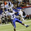 Photo - Duke running back Josh Snead, top, celebrates with Duke wide receiver Jamison Crowder (3) after Snead scored a touchdown against Texas A&M in the first half of the Chick-fil-A Bowl NCAA college football game Tuesday, Dec. 31, 2013, in Atlanta. (AP Photo/Jamie Martin)