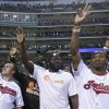 Photo - Cleveland Browns quarterback Johnny Manziel, left, and Browns rookies wave to fans before the Cleveland Indians play the Boston Red Sox in a baseball game, Wednesday, June 4, 2014, in Cleveland. (AP Photo/Tony Dejak)