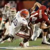 Oklahoma\'s Sam Bradford (14) is sacked by Florida\'s Brandon Hicks (40) during the first quarter of the BCS Championship NCAA college football game Thursday, Jan. 8, 2009, in Miami. (AP Photo/J. Pat Carter)