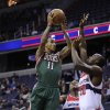 Milwaukee Bucks guard Monta Ellis (11) goes to the basket against Washington Wizards center Emeka Okafor (50) and Bradley Beal (3) during the first half of an NBA basketball game on Friday, Nov. 9, 2012, in Washington. (AP Photo/Nick Wass)