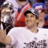 New York Giants quarterback Eli Manning holds the Vince Lombardi Trophy after the NFL Super Bowl XLVI football game against the New England Patriots, Sunday, Feb. 5, 2012, in Indianapolis. The Giants won 21-17. (AP Photo/Charlie Riedel) ORG XMIT: SB533