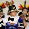 """Seated in the front are the preachers in the play, from left, Andruw (cq) Chaffin, Jaden Harper and Drake Wilson. Kindergarten students perform a musical play, """"Hurrah for Thanksgiving"""" at John Glenn Elementary School in the school cafeteria on Monday, Nov. 25, 2013. Students dressed as Pilgrims, Indians and turkeys. Music teacher Karen Bentley directed the play and Principal Archie Scott was the narrator. Photo by Jim Beckel, The Oklahoman"""