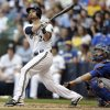 Milwaukee Brewers\' Jonathan Lucroy, left, watches his home run against the New York Mets during the third inning of a baseball game on Saturday, July 6, 2013, in Milwaukee. (AP Photo/Jeffrey Phelps)