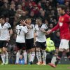 Photo - Fulham's Steve Sidwell, centre, celebrates with teammates after scoring against Manchester United during their English Premier League soccer match at Old Trafford Stadium, Manchester, England, Sunday Feb. 9, 2014. (AP Photo/Jon Super)