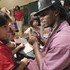 University of Oklahoma (OU) defensive back Quinton Carter signs autographs as he helps out with a tutoring/mentoring session at Kinder Care on Wednesday, June 30, 2010, in Norman Okla. Carter is giving back -- in a big way. Even though he\'s still in college, he has already started a charitable foundation and is heavily involved in projects in Norman and in his hometown of Las Vegas. Photo by Steve Sisney, The Oklahoman