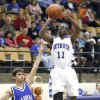 Photo -  Guthrie's J.T. McFadden shoots over Harrah's J.J. Jaworski during Tuesday's game.