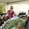 Charity Middleton, left, pours wine for Rhonda and Eric Brinsfield of Midwest City at the Made in Oklahoma Festival held inside and on the grounds of the Reed Conference Center at the Sheraton Midwest City Hotel Saturday afternoon, May, 19, 2012. Middleton was providing samples of made at the Woods and Waters Winery and Vineyards in Anadarko. Photo by Jim Beckel, The Oklahoman