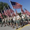 Boy Scouts carry American flags during the Edmond LibertyFest Parade in downtown Edmond, Okla., on Independence Day, Friday, July 4, 2014. Photo by Nate Billings, The Oklahoman
