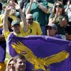 Photo -   A Tennesse Tech fan, right, and Oregon fan react in the stands during the first half of the NCAA college football game in Eugene, Ore., Saturday, Sept. 15, 2012.(AP Photo/Don Ryan)