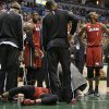 CORRECTS SPELLING TO DWYANE, INSTEAD OF DWAYNE - Miami Heat\'s Dwyane Wade lies on the court during the first half against the Milwaukee Bucks in an NBA basketball game Friday, March 15, 2013, in Milwaukee. (AP Photo/Jeffrey Phelps)