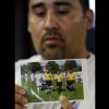 Photo - FILE - In this Thursday, May 2, 2013 file photo, Jose Lopez points to an undated photo of Ricardo Portillo, center, his brother-in-law, following a news conference, at Intermountain Medical Center, in Murray, Utah. Portillo, a 46-year-old soccer referee who was punched by a teenage player during a game and later slipped into a coma died Saturday night, May 4, 2013, police said. (AP Photo/Rick Bowmer, File)