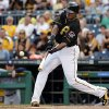 Photo - Pittsburgh Pirates' Gregory Polanco drives in a run with a single off San Diego Padres starting pitcher Ian Kennedy during the first inning of a baseball game in Pittsburgh, Friday, Aug. 8, 2014. (AP Photo/Gene J. Puskar)