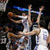 /tokcon/ goes to the basket past San Antonio\'s Tim Duncan (21) during an NBA basketball game between the Oklahoma City Thunder and the San Antonio Spurs at Chesapeake Energy Arena in Oklahoma City, Thursday, April 3, 2014. Photo by Bryan Terry, The Oklahoman
