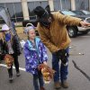 Norman Round-up Club volunteer Joe Inman helps a girl become familiar with the course before she sets off on a stick-horse race in the parking lot. Children with their parents endured cold temperatures and intermittent rain to come to the grounds of the Oklahoma History Center on Saturday, March 23, 2013, to participate in the 3rd annual Cowboy Round-up, billed to be a