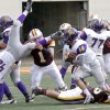 Anadarko\'s Kris Whitfield (42) is upended as Brandon Pollard (18) looks for running room past the Clinton defense during the Class 4A Oklahoma state championship football game between Anadarko and Clinton at Boone Pickens Stadium on Saturday, Dec. 1, 2012, in Stillwater, Okla. Photo by Chris Landsberger, The Oklahoman