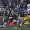 Nevada\'s Kendall Brock (20) runs into the end zone followed by Wyoming\'s Darrenn White (13) during the first half of an NCAA college football game in Reno, Nev., on Saturday, Oct. 6, 2012. (AP Photo/Cathleen Allison)