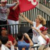 Women\'s basketball head coach Sherri Coale carries an OU flag through the stands at the NCAA Super Regional softball game as the University of Oklahoma (OU) Sooners defeats Texas A&M 10-2 at Marita Hines Field on Friday, May 24, 2013 in Norman, Okla. Photo by Steve Sisney, The Oklahoman