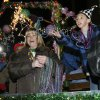 Jamie Howard and Zach Keller throw beads from a float in the Norman Mardi Gras Parade in Norman, Oklahoma, on Saturday February 21, 2009. Photo by Steve Sisney, The Oklahoman