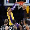 Los Angeles Lakers\' Dwight Howard, top, dunks as San Antonio Spurs\' Tiago Splitter (22), of Brazil, Stephen Jackson (3) and Tim Duncan watch in the first half of an NBA basketball game in Los Angeles, Tuesday, Nov. 13, 2012. (AP Photo/Jae C. Hong)