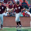 Photo - Mississippi State's Jake Vickerson (22) celebrates with Seth Heck (18) after scoring on a ball hit by Derrick Armstrong in the sixth inning during an NCAA college baseball tournament regional game against Jacksonville State  in Lafayette, La., Saturday, May 31, 2014. Mississippi State won 3-1. (AP Photo/Jonathan Bachman)