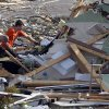 Residents comb through debris looking for personal belongings after a possible tornado ripped through the Georgebrook subdivision area in Trussville, Ala. in the early hours of Monday, Jan. 23, 2012. (AP Photo/Butch Dill) ORG XMIT: ALBD117