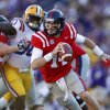 Mississippi quarterback Bo Wallace (14) scrambles as LSU defensive tackle Anthony Johnson (90) rushes in the first half of their NCAA college football game in Baton Rouge, La., Saturday, Nov. 17, 2012. (AP Photo/Gerald Herbert)