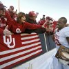 Oklahoma\'s Gerald McCoy celebrates with fans after the Sooners 31-27 win over Stanford in the Brut Sun Bowl college football game between the University of Oklahoma Sooners (OU) and the Stanford University Cardinal on Thursday, Dec. 31, 2009, in El Paso, Tex. Photo by Chris Landsberger, The Oklahoman