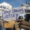 Residents of a flood-wrecked home in Point Pleasant Beach N.J. offer encouragement to fellow victims of Superstorm Sandy on Monday, Nov. 5, 2012, in this message scrawled on the bottom of a waterlogged mattress. A new storm, this one a nor\'easter, was due to hit the shore Wednesday, raising fears of renewed damage and flooding. (AP Photo/Wayne Parry)