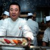 In this Jan. 10, 2007 file photo, celebrity Japanese chef Nobuyuki Matsuhisa shows off an assortment of sushi pieces he prepared for his new restaurant Nobu, at a press availability, in Hong Kong. Matsuhisa will be honored Saturday, Feb. 23, 2013, at the South Beach Wine and Food Festival for his fusion cuisine that blends Japanese and South American ingredients. (AP Photo/Lo Sai-hung)