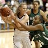 EDLAM: Edmond Memorial\'s Alie Decker fights with Edmond Santa Fe\'s Daisha Gonzaque for the ball during a girls high school basketball game at Edmond Memorial on Tuesday, January 25, 2010. Photo by Bryan Terry, The Oklahoman