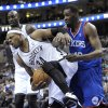Photo - Brooklyn Nets' Paul Pierce (34) steals the ball from  Philadelphia 76ers' Jarvis Varnado from during the first half of an NBA basketball game on Saturday, April 5, 2014, in Philadelphia. (AP Photo/Michael Perez)