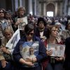 People holding images of Pope Francis attend Mass at the Metropolitan Cathedral in Buenos Aires, Argentina, Sunday, March 17, 2013. Argentine\'s former Cardinal Jorge Mario Bergoglio was chosen as leader of the Catholic Church on March 13, 2013. (AP Photo/Natacha Pisarenko)