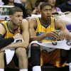 New Orleans Hornets Austin Rivers, left, and Anthony Davis, right, react from the bench during the second half of an NBA basketball game against the Oklahoma City Thunder in New Orleans, Friday, Nov. 16, 2012. The Thunder won 110-95. (AP Photo/Jonathan Bachman) ORG XMIT: LAJB109