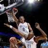 Oklahoma City\'s Kevin Durant, left, Russell Westbrook, and Damien Wilkins foul Devin Brown of the Hornets during the NBA basketball game between the Oklahoma City Thunder and the New Orleans Hornets at the Ford Center in Oklahoma City on Friday, Nov. 21, 2008. BY BRYAN TERRY, THE OKLAHOMAN