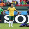 Photo - Referee Djamel Haimoudi, left, from Algeria warns Australia's Tim Cahill, center, after Cahill collided with Netherlands' Bruno Martins Indi during the group B World Cup soccer match between Australia and the Netherlands at the Estadio Beira-Rio in Porto Alegre, Brazil, Wednesday, June 18, 2014. Martins Indi was carried off the pitch in a stretcher. (AP Photo/Jon Super)