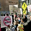 A group of demonstrators march in downtown Grand Rapips, Mich calling for Dick DeVos to end financial support for right-to-work legislation, Wednesday, Dec. 5, 2012. (AP Photo/The Grand Rapids Press, Chris Clark) ALL LOCAL TV OUT; LOCAL TV INTERNET OUT