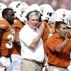 Photo - Texas head coach Mack Brown, center, talks into his headset during the first half of an NCAA college football game against Oklahoma at the Cotton Bowl  Saturday, Oct. 12, 2013, in Dallas. (AP Photo/LM Otero)