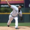 Photo - Colorado Rockies starting pitcher Juan Nicasio works against the San Diego Padres in the first inning of a baseball game in Denver on Sunday, May 18, 2014. (AP Photo/David Zalubowski)