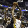 Miami Heat\'s LeBron James, center, puts up a shot against Indiana Pacers\' Paul George, left, and George Hill during the first half of Game 3 of the NBA Eastern Conference basketball finals in Indianapolis, Sunday, May 26, 2013. (AP Photo/Nam H. Huh)