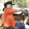 OSU President Burns Hargis waves to the crowd during the Oklahoma State Cowboy\'s homecoming parade in downtown Stillwater, OK, Saturday, Oct. 29, 2011. By Paul Hellstern, The Oklahoman