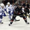 Photo - Carolina Hurricanes' Radek Dvorak (18), of the Czech Republic, chases the puck with Toronto Maple Leafs' Dion Phaneuf (3) and Tim Gleason (8) during the second period of an NHL hockey game in Raleigh, N.C., Thursday, Jan. 9, 2014. (AP Photo/Gerry Broome)
