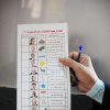 An Egyptian woman holds a ballot paper with names of the 13 presidential candidates inside a polling station, in Giza, Egypt, Wednesday, May 23, 2012. More than 15 months after autocratic leader Hosni Mubarak\'s ouster, Egyptians streamed to polling stations Wednesday to freely choose a president for the first time in generations. (AP Photo/Mohammed Asad) ORG XMIT: CAI113