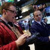 Photo -  Trader Ryan Falvey, left, and specialist Jason Notter, work Tuesday on the floor of the New York Stock Exchange.  AP Photo   Richard Drew -