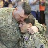 Sergeant Darron Turner hugs Kevin Summerlin after Summerlin was awarded the Purple Heart during the welcome home ceremony. About 250 members of the The Oklahoma National Guard, 45th Infantry Brigade Combat Team (IBCT) returned from Afghanistan and Kuwait on Wednesday, March 28, 2012. Photo By David McDaniel/The Oklahoman