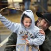 A boy gets tips on throwing a lasso from a volunteer with the Norman Round-up Club. Children with their parents endured cold temperatures and intermittent rain to come to the grounds of the Oklahoma History Center on Saturday, March 23, 2013, to participate in the 3rd annual Cowboy Round-up, billed to be a