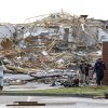 Residents and others walk by the remains of the First Baptist Church following a tornado that destroyed the town Wednesday, April 27, 2011 in Smithville, Miss..(AP Photo/Northeast Mississippi Daily Journal, Thomas Wells)