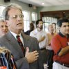 Photo - U.S. Sen. Tom Coburn, R-Muskogee, stands with Rotarians to recite the Pledge of Allegiance at the start of the meeting. The senator was a guest at the Edmond Rotary Club meeting Wednesday, Aug. 8, 2007.  While there, he spoke and answered questions from club members for about 45 minutes. By Jim Beckel,  The Oklahoman.  ORG XMIT: KOD