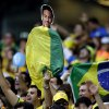 Photo - A Brazil supporter holds up a flag draped cutout of Brazil's Neymar before the World Cup semifinal soccer match between Brazil and Germany at the Mineirao Stadium in Belo Horizonte, Brazil, Tuesday, July 8, 2014. (AP Photo/Andre Penner)
