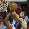 Golden State Warriors\' Andrew Bogut, right, blocks a shot by Houston Rockets\' James Harden (13) during the first quarter of an NBA basketball game, Tuesday, Feb. 5, 2013, in Houston. (AP Photo/Dave Einsel)