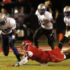 GHS #15 L\'liott Curry goes for a fumble by CA #3 Stevie Thompson as Thomson tries to stop him, but GHS recovered, during the high school football game between Guthrie at Carl Albert in Midwest City, Friday, October 11, 2013. Photo by Doug Hoke, The Oklahoman